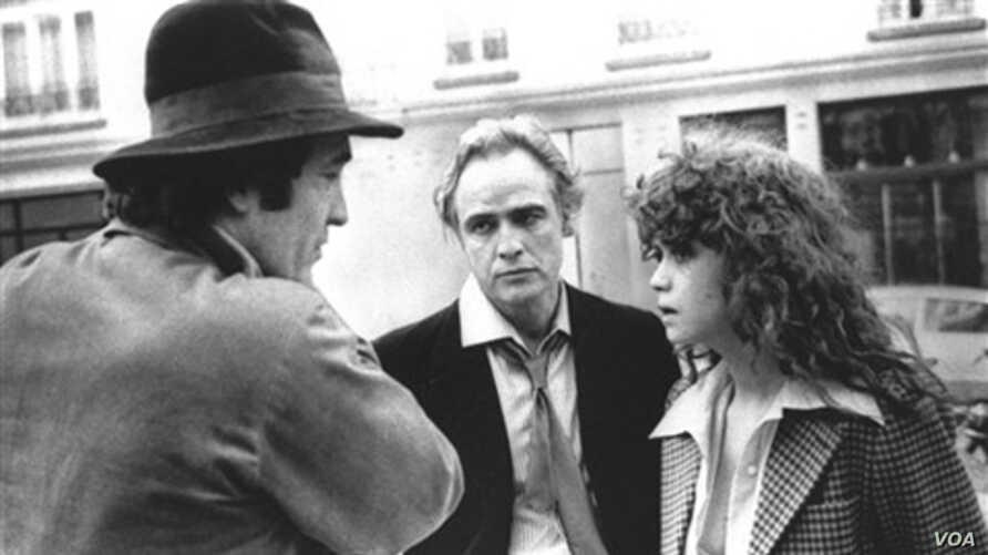 """Bertolucci con Brando y Schneider en el rodaje de """"Nueve semanas y media""""."""